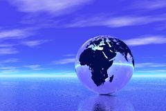 Globe in ocean Stock Image