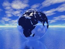 Globe in ocean Royalty Free Stock Photo