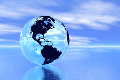 Globe in ocean Stock Images