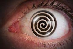 Globe oculaire de remous d'hypnose photographie stock