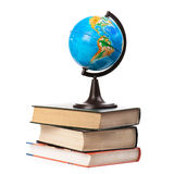 Globe on old books isolated Royalty Free Stock Photo