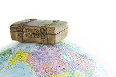 Globe and Old brown suitcase Royalty Free Stock Images