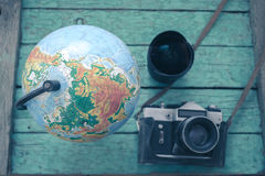 Globe on an old green wooden boards Stock Photo