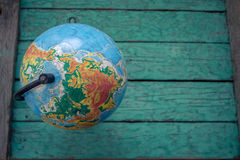 Globe on an old green wooden boards Royalty Free Stock Photography