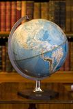 Globe in old library Stock Photos