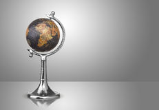 Globe. Old style globe on gray background Royalty Free Stock Images