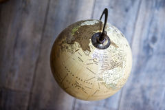 Globe. Old terrestrial globe on a wooden floor Royalty Free Stock Photography