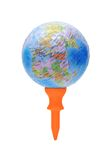 Globe on orange golf tee Stock Photography