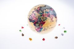 Globe orbit and crumpled papers. On a white background royalty free stock photo
