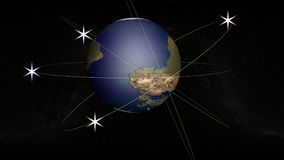 The globe with the orbits. The globe on the background of the starry sky. Four orbits surround the globe. Four satellites are shining in orbit. They are Stock Image