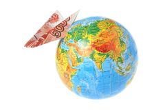 Globe with origami plane made from banknote isolated on white Royalty Free Stock Photo