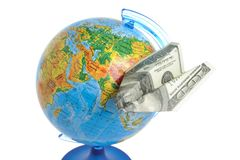 Globe with origami plane made from dollar isolated on white Royalty Free Stock Photo