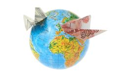 Globe with origami planes made from money isolated on white Royalty Free Stock Photography