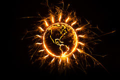 Globe outline in sparks Stock Photo