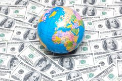 Globe over many american dollar notes Stock Photo