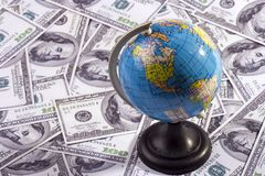 Globe Over Money Royalty Free Stock Images