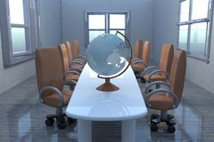 Globe over a table in meeting room Royalty Free Stock Photos