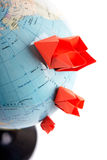 Globe with paper ships Royalty Free Stock Photos