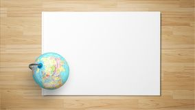 Globe on paper on wooden background royalty free stock photo