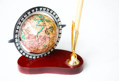 Globe and pen holder Stock Images