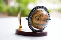Globe and pen holder Royalty Free Stock Photo