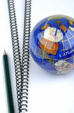 Globe, pencil and books. Document books and colorful globe with a pencil, means world wide information, global concept and analysis for earth or world economy Stock Photography