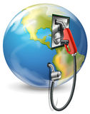 A globe and a petrol pump Royalty Free Stock Photos