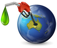 A globe with a petrol pump Royalty Free Stock Images