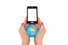 Globe and phone in two hands Royalty Free Stock Photography