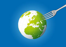 Globe pick on fork Royalty Free Stock Image