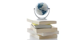 Globe on pile of books Royalty Free Stock Images