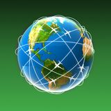 Globe with plane. On a green background Stock Photos