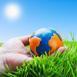 Globe of the plasticine in the hand royalty free stock photos