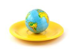 Globe on a plate Stock Photo
