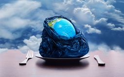 Globe on the plate Royalty Free Stock Photography