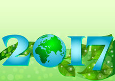 2017 with globe and plume of green leaves Royalty Free Stock Image