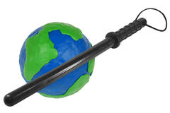 Globe and police baton Royalty Free Stock Image