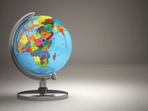 Globe with political map on grey background. Stock Photo