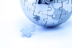 Globe puzzle Stock Photos