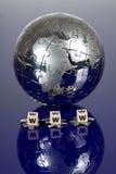 Globe puzzle on blue background Stock Photos