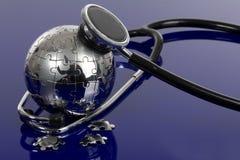 Globe puzzle on blue background. Stock Photos