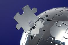 Globe puzzle on blue background Stock Photo