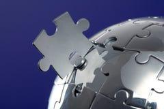 Globe puzzle on blue background stock photo