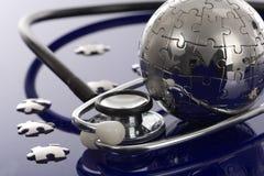 Globe puzzle on blue background. stock image