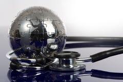 Globe puzzle on blue background. Stock Photo