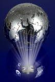 Globe puzzle on blue background stock photography