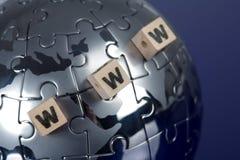 Globe puzzle on blue background Royalty Free Stock Photography
