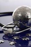 Globe puzzle on blue background. stock photography