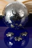 Globe puzzle with book royalty free stock image