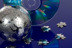 Globe puzzle with CD Royalty Free Stock Image